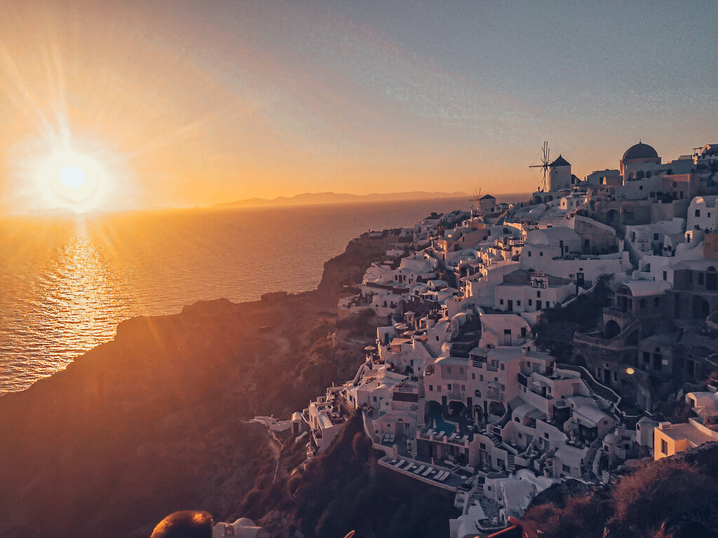 Solo Female Travel - Experiences in Santorini Greece the famous sunset at Oia in Santorini