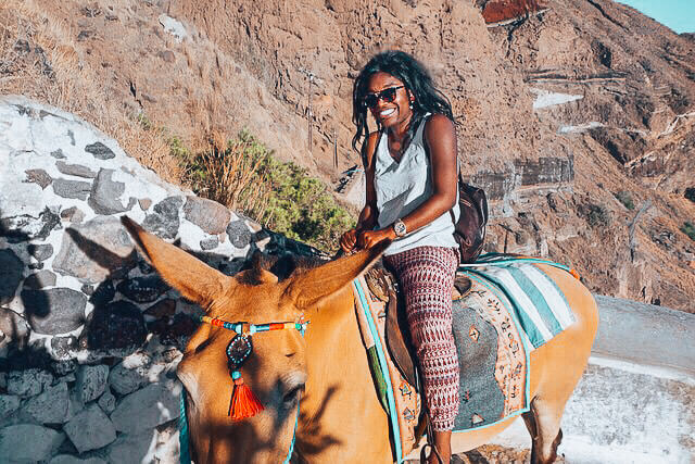 Solo Female Travel - Experiences in Santorini Greece Riding a Donkey