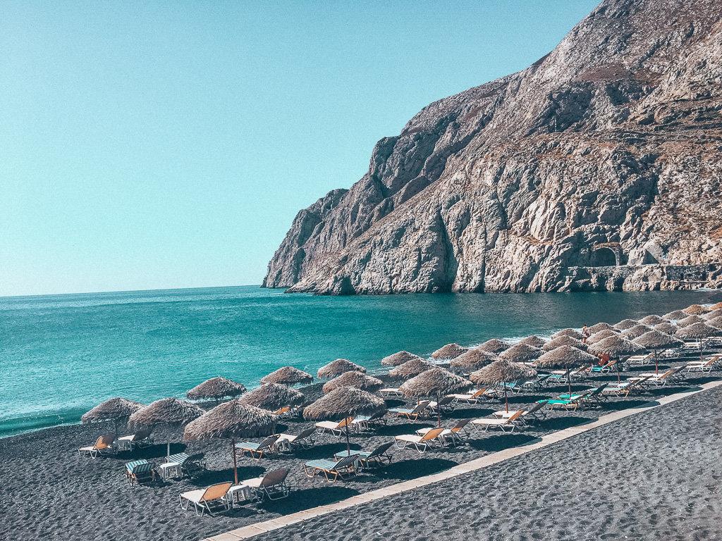 Solo Female Travel - Experiences in Santorini Greece the black sand beach in Kamari