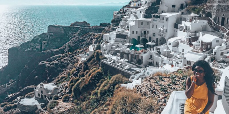 Walking up the narrow streets of Oia with a smile on my face