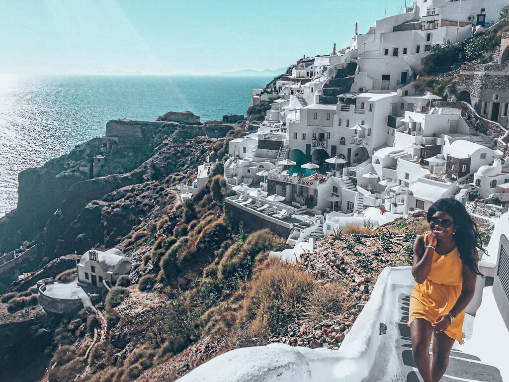 Solo Female Travel - Experiences in Santorini Greece Walking up stairs in Oia