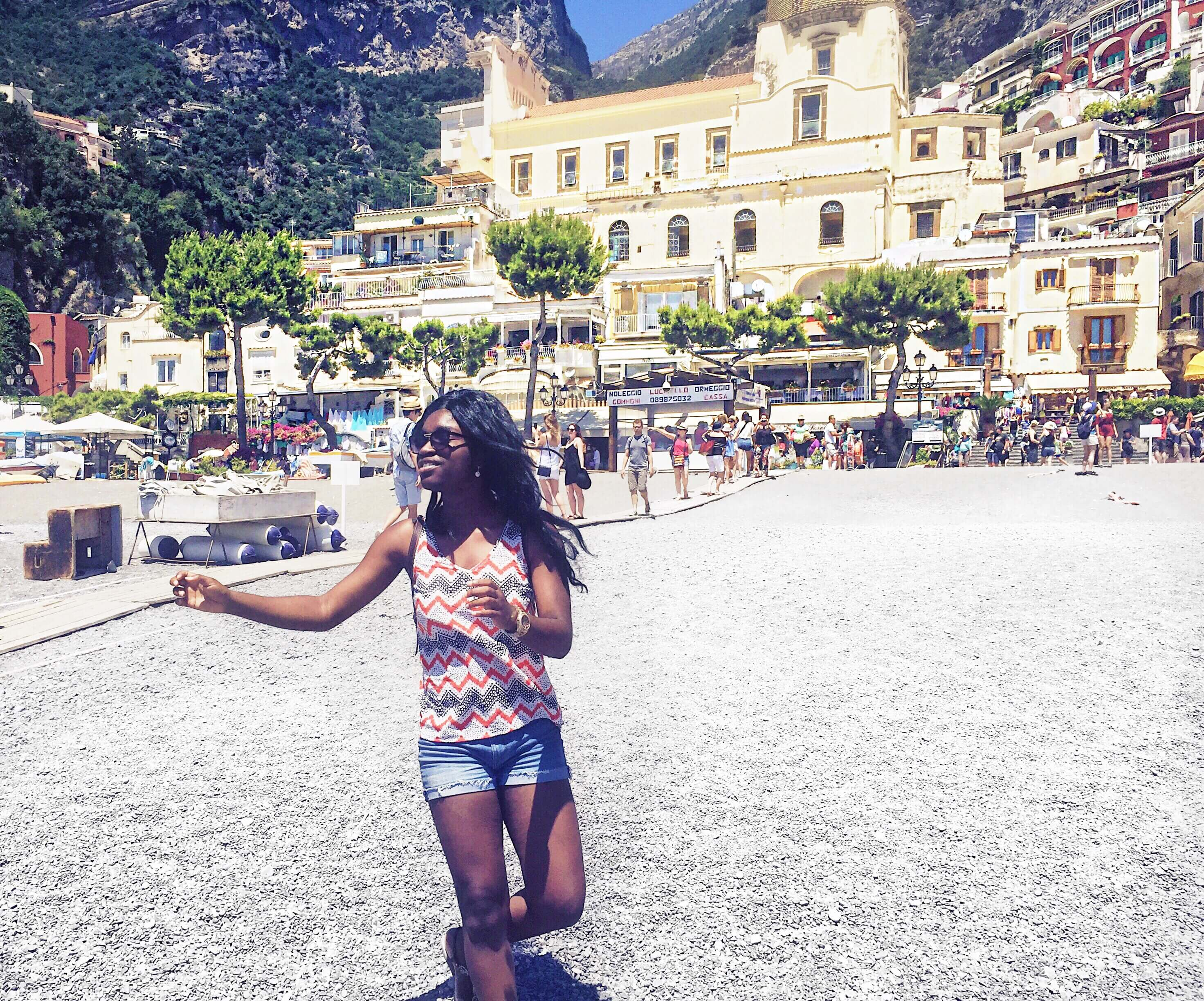 Somto skipping for joy on the beach in Positano