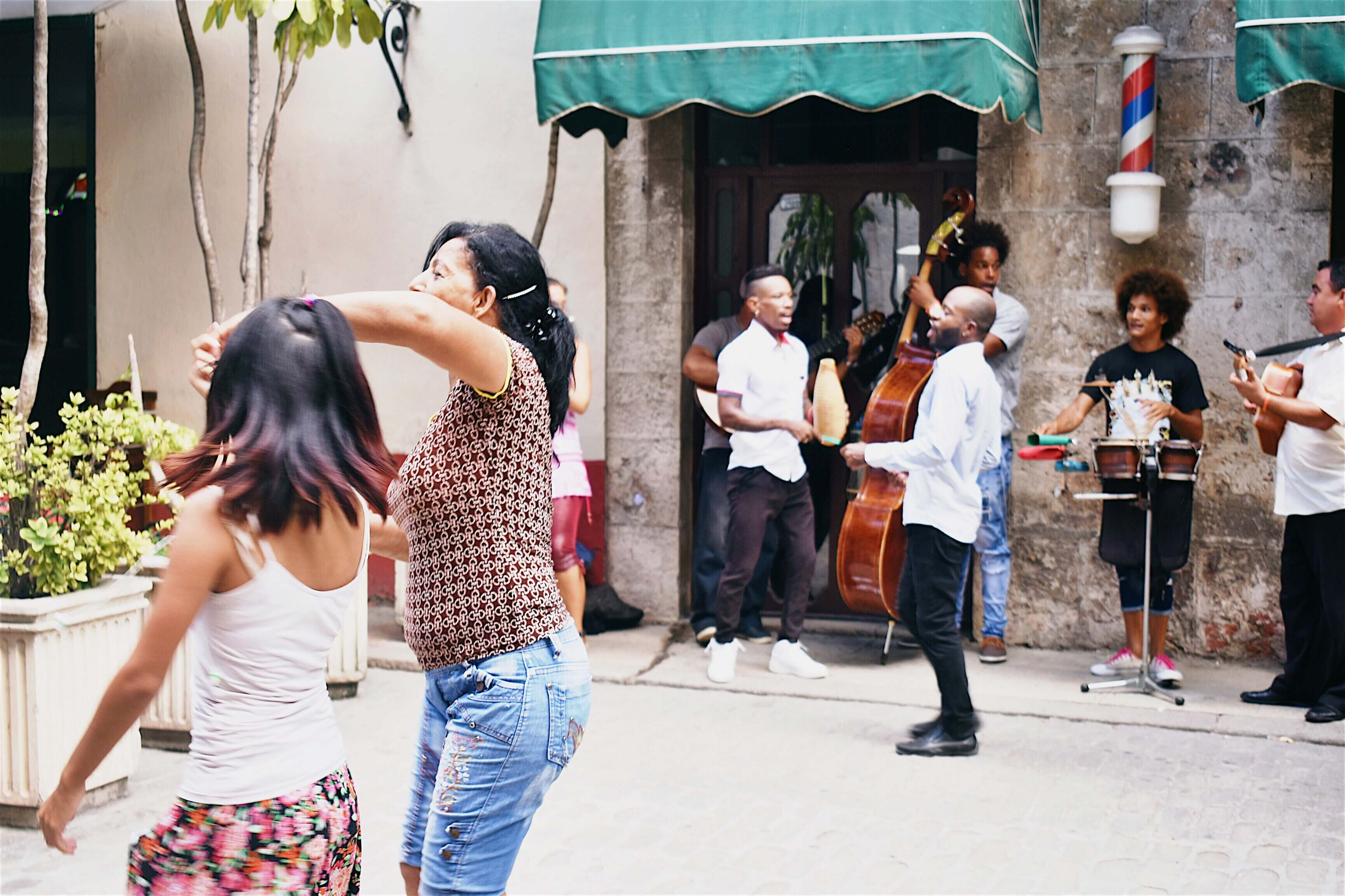 People singing and dancing salsa on the streets