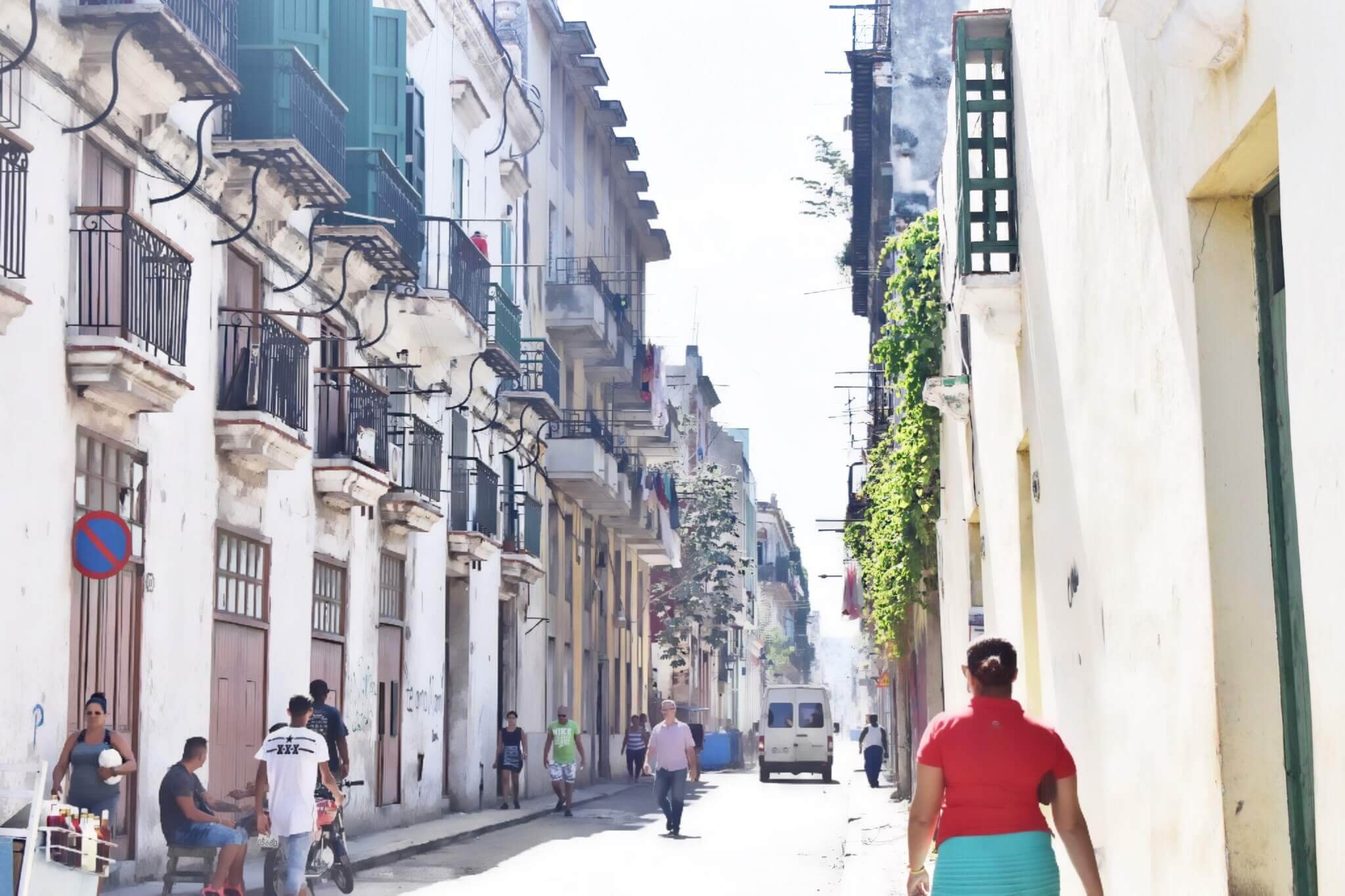 A woman walking down the colorful streets of Havana Vieja (Old Havana). This area is so charming!