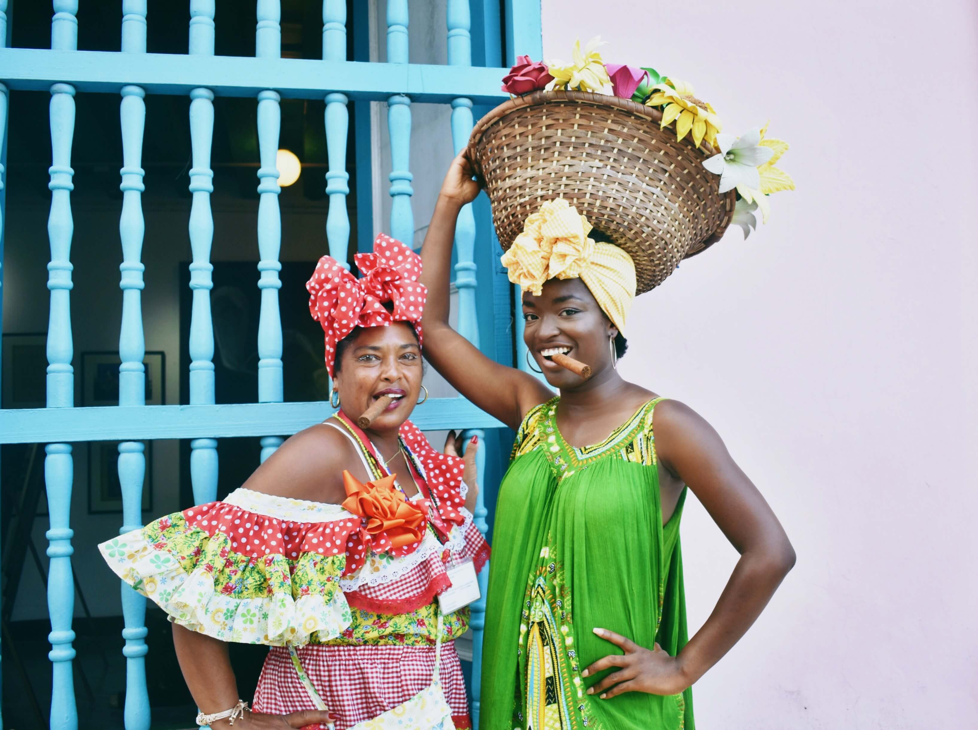 Somto posing with Laza, an Afro-Cubana in colorful clothes, on the streets of Havana Vieja