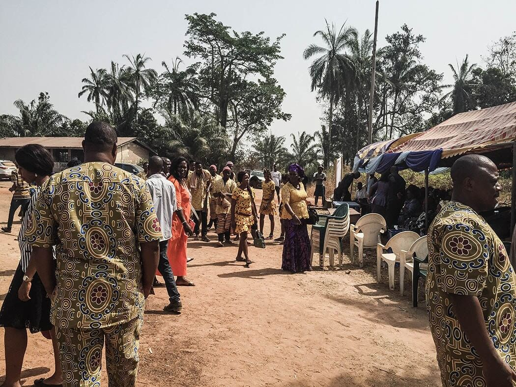 A scene at the funeral with guests walking around