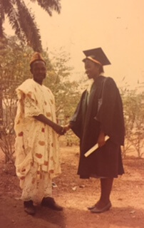 Papa Onitsha and my mom shaking hands at her college graduation