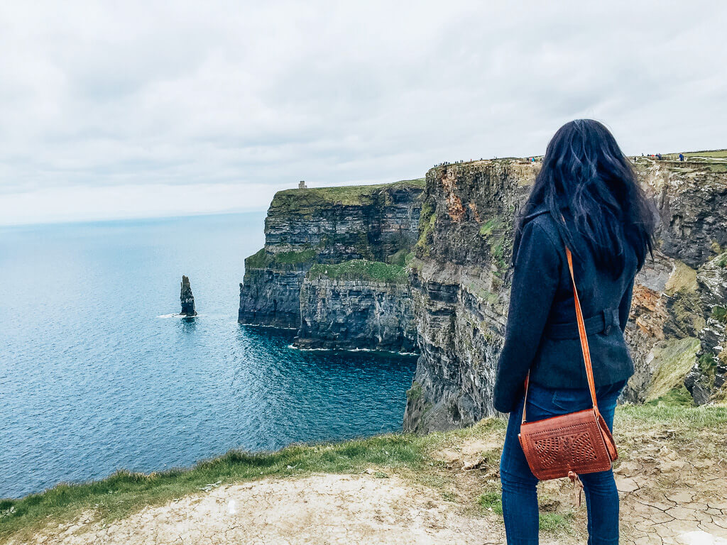 Looking out into the horizon at the Cliffs of Moher
