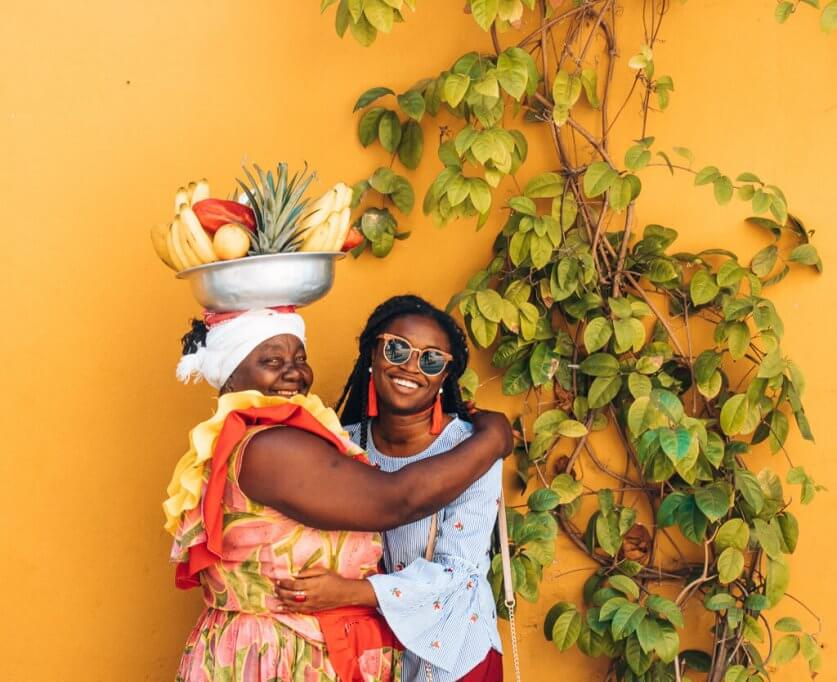 Colombia travel bucket list - posing with Palenquera Valentina in Cartagena