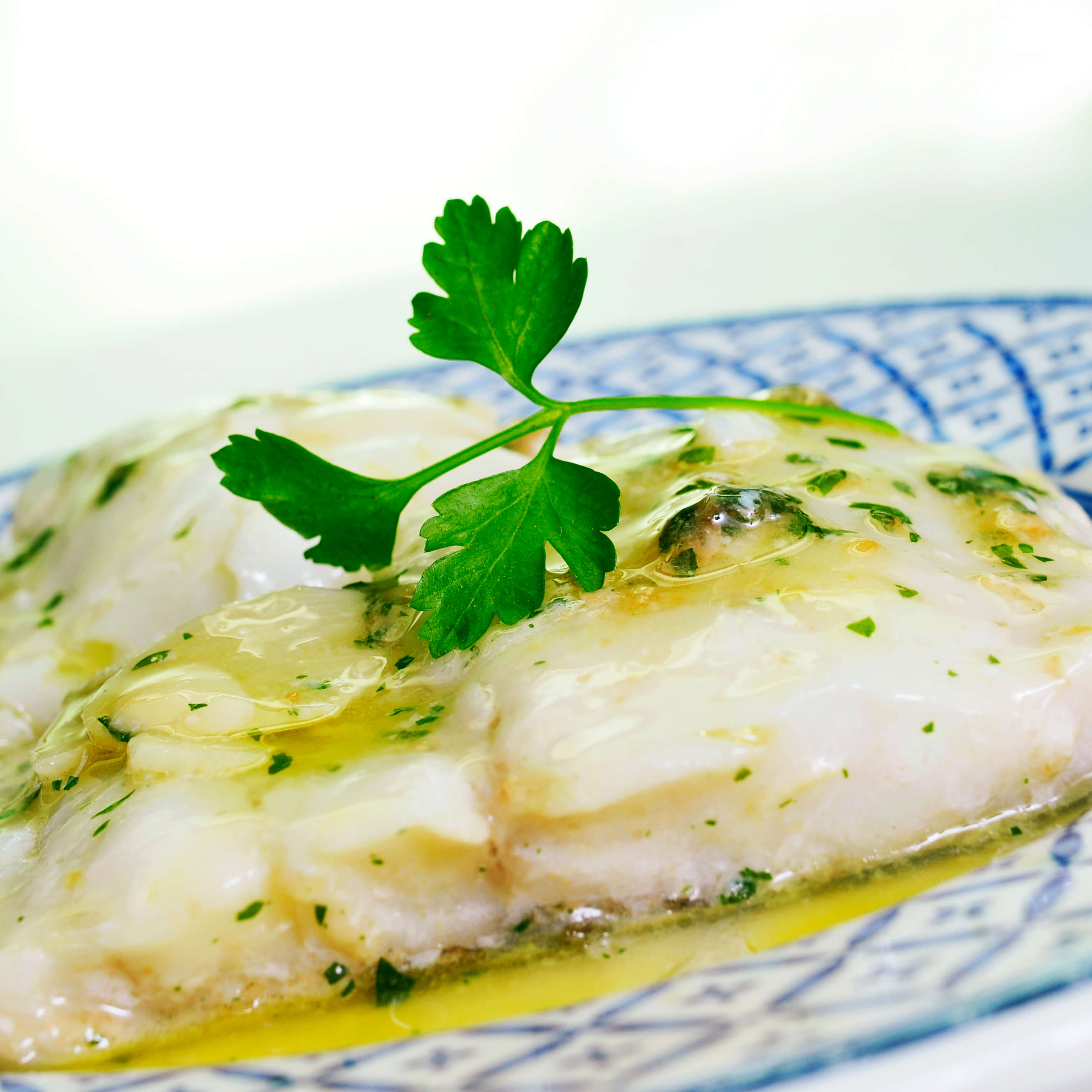 6 Dishes to Eat in Spain Besides Paella and Tapas - Bacalao al Pil Pil
