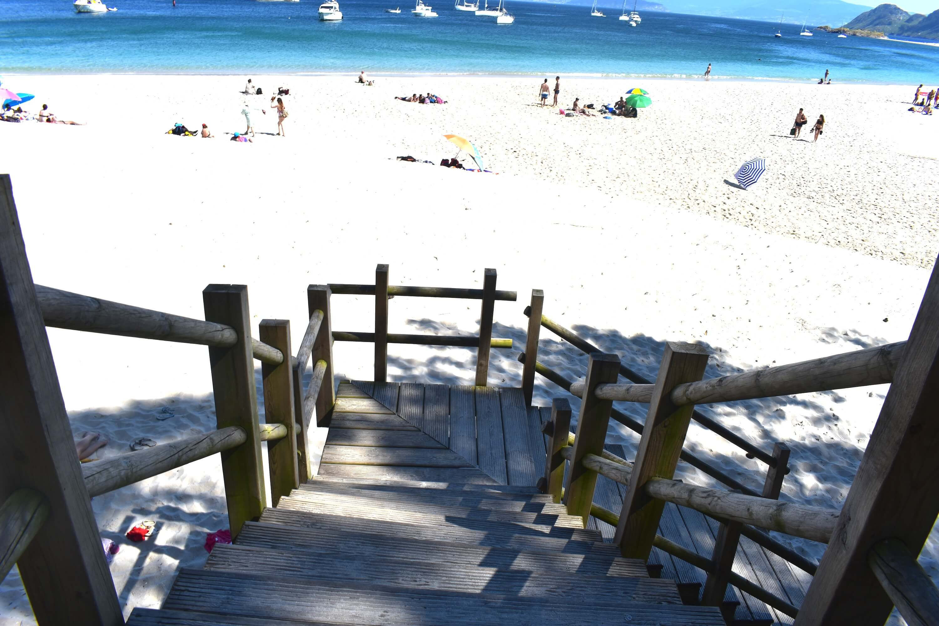 20 photos that will inspire you to visit the Cies Islands - Galicia Travel Spain Stairs at Rodas Beach of the Cies Islands