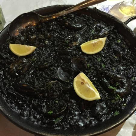 10 Unconventional Tips for Women Traveling Solo in Spain - try squid ink Paella.