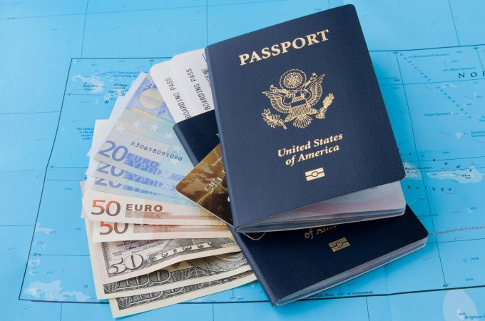 15 easy tips to save money while traveling abroad - feature image