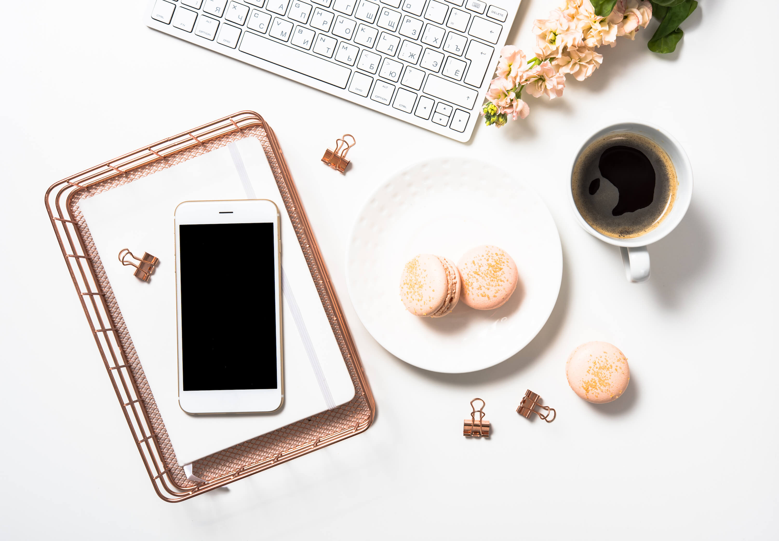 How to build an email list for your travel blog - coffee and macaroons on desk