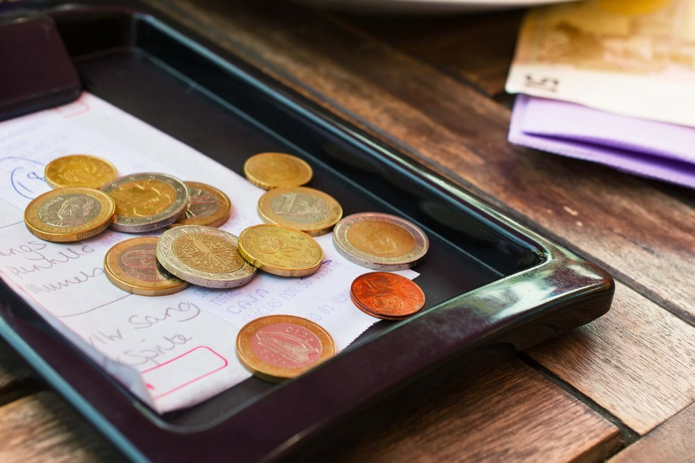 Things not to do in Barcelona - Coins at a Spanish restaurant