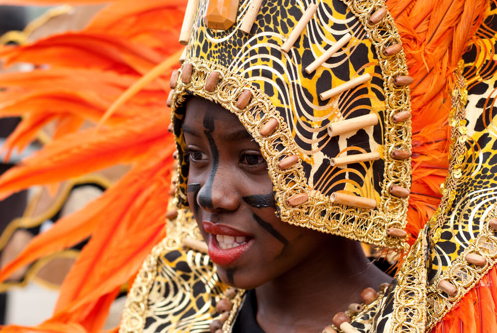 Traveling to normalize blackness - black girl at Caribbean carnaval