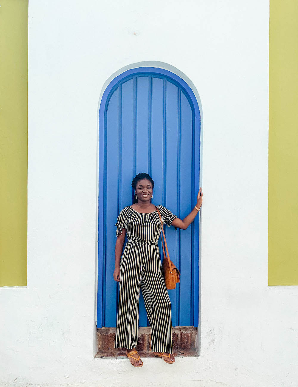Standing by a door in Old San Juan