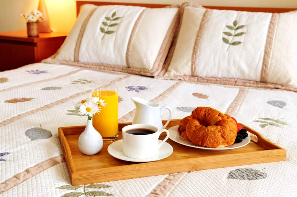 Hotel guestroom with breakfast in bed